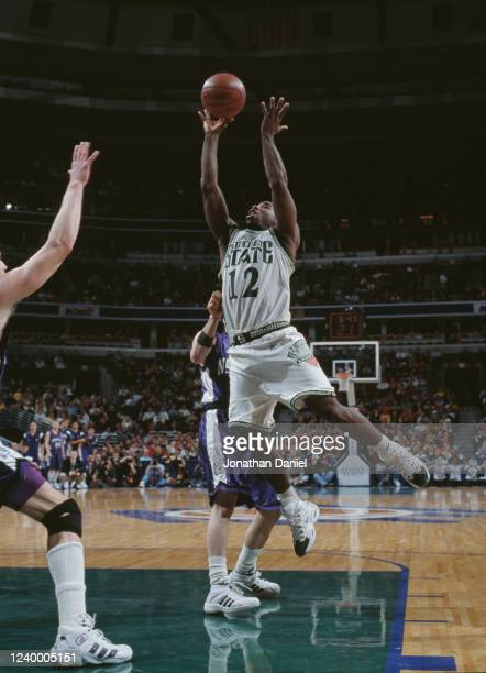 Mateen Cleaves Guard for the Michigan State Spartans drives to the hoop during the NCAA Big10 Conference tournament college basketball game against...