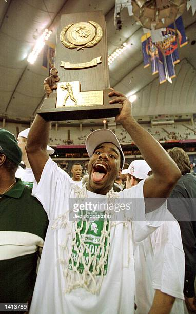 Mateen Cleaves of Michigan State celebrates with the National Championship trophy after his team defeated Florida 8976 in the championship game at...