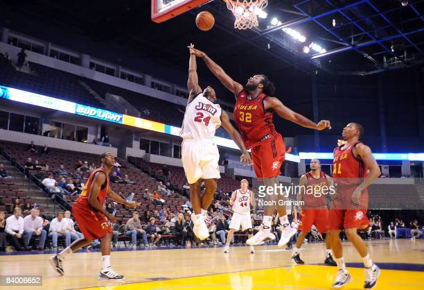 Mateen Cleaves of the Bakersfield Jam puts a shot up against Chris Richard of the Tulsa 66ers at Rabobank Arena on December 11, 2008 in Bakersfield,...
