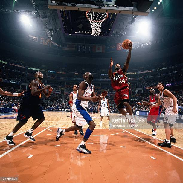 Mateen Cleaves of the Rookies attempts a layup against Lamar Odom of the Sophmores during the 2001 Rookie Challenge on February 10, 2001 at the MCI...