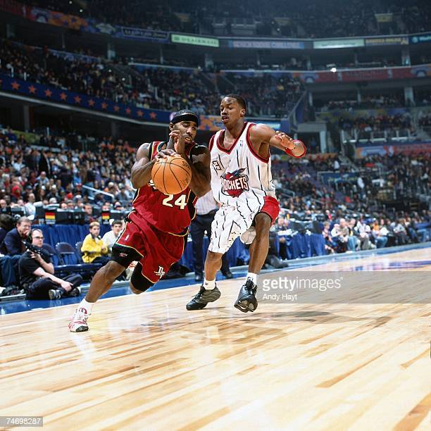 Mateen Cleaves of the Rookies dribbles by Steve Francis of the Sophmores during the 2001 Rookie Challenge on February 10, 2001 at the MCI Center in...