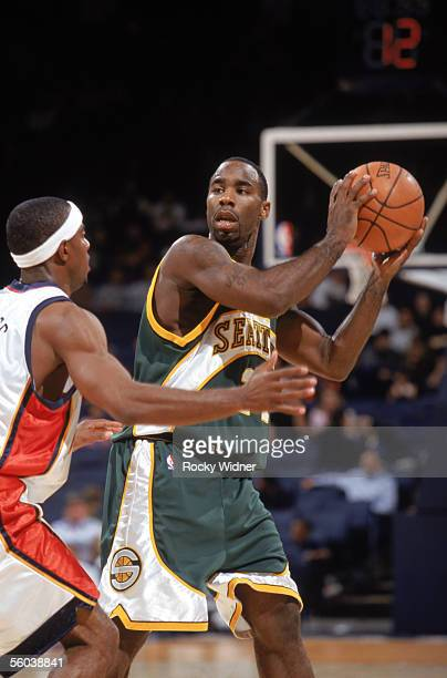 Mateen Cleaves of the Seattle Sonics looks to pass over Aaron Miles of the Golden State Warriors during a preseason game at The Arena in Oakland on...
