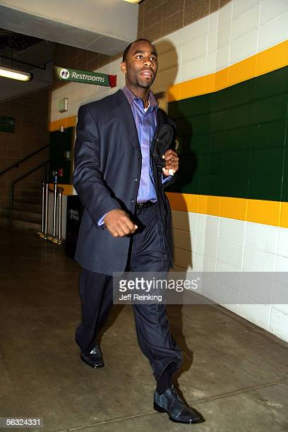 Mateen Cleaves of the Seattle SuperSonics enters the building and walks toward the locker room before a game against the Cleveland Cavaliers at Key...
