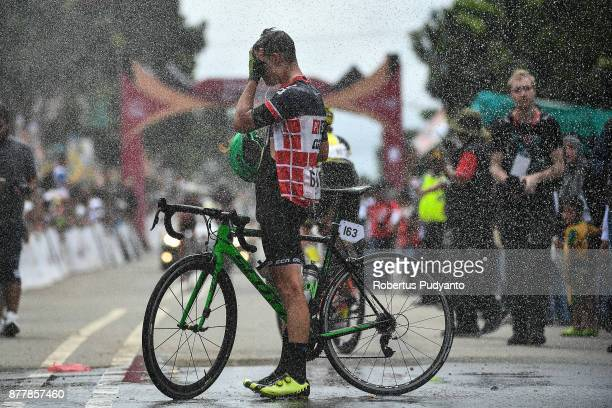 Matej Drinovec of Slovenia and PCS TeamProcyclingstatscom Laos is sprayed with water canon after finished in stage 6 of the Tour de Singkarak 2017...