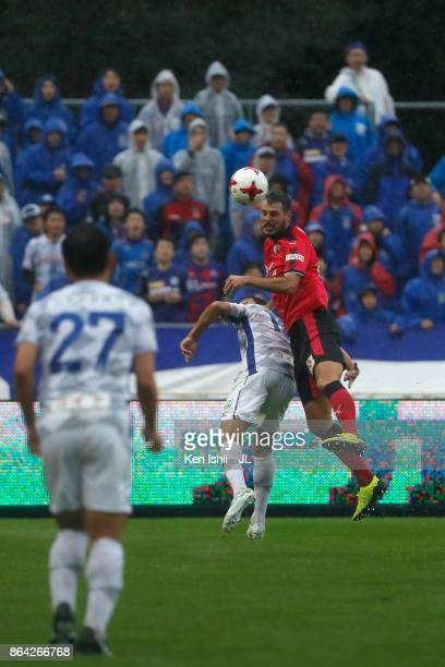 Matej Jonjic of Cerezo Osaka and Dudu of Ventforet Kofu compete for the ball during the JLeague J1 match between Cerezo Osaka and Ventforet Kofu at...