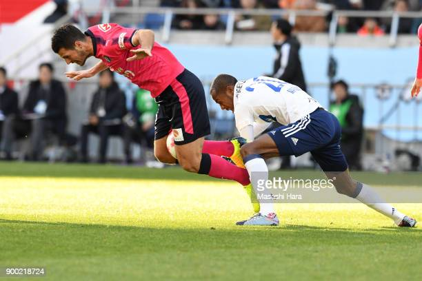 Matej Jonjic of Cerezo Osaka and Martinus of Yokohama Fmarinos compete for the ball during the 97th All Japan Football Championship final between...