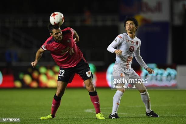 Matej Jonjic of Cerezo Osaka and Yusuke Segawa of Omiya Ardija compete for the ball during the JLeague J1 match between Cerezo Osaka and Omiya Ardija...