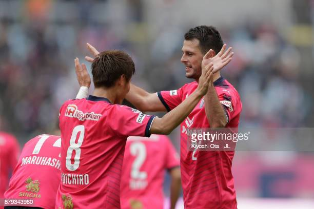 Matej Jonjic of Cerezo Osaka celebrates scoring his side's second goal with his team mate Yoichiro Kakitani during the JLeague J1 match between...