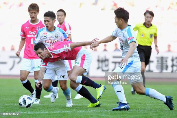 Matej Jonjic of Cerezo Osaka competes for the ball against Ryota Oshima and Kei Chinen of Kawasaki Frontale during the JLeague J1 match between...
