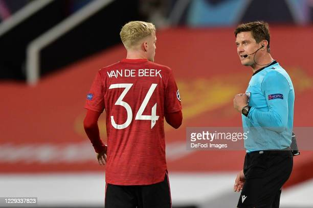 Matej Jug and Donny van de Beek of Manchester United speak during the UEFA Champions League Group H stage match between Manchester United and RB...
