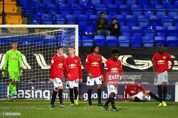 Matej Kovar Mark Helm Ethan Galbraith D'Mani BughailMellor Angel Gomes and Ayodeji Sotona of Manchester United U21s react to conceding a goal during...