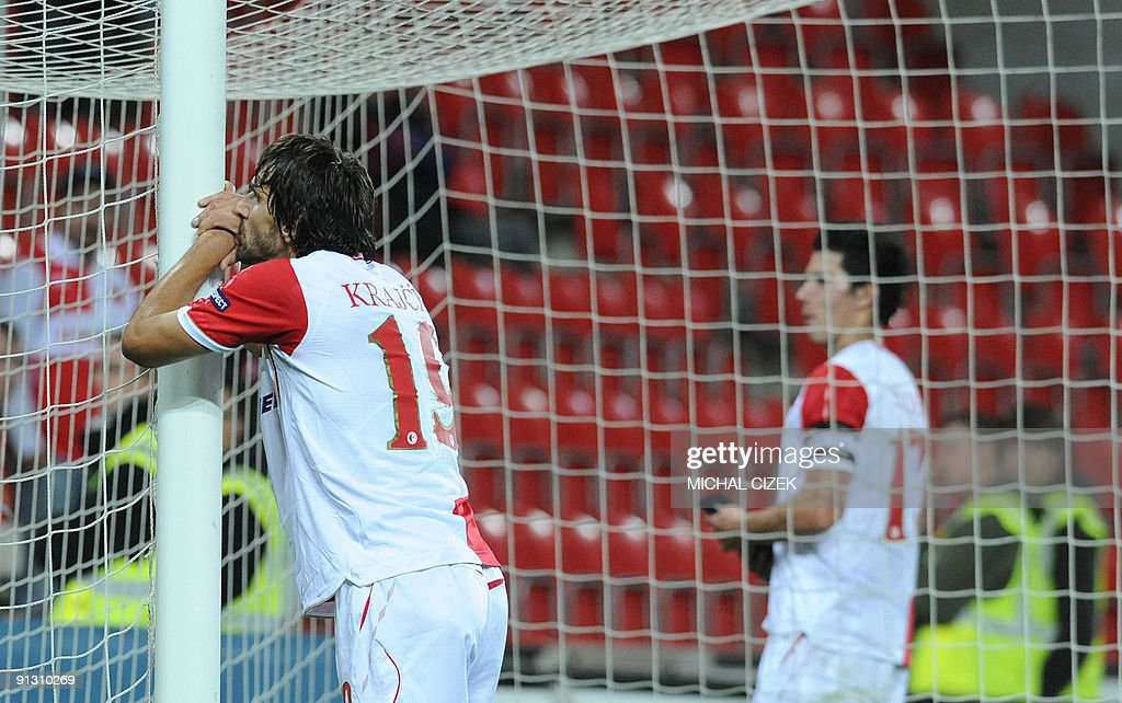 Matej Krejcik of Slavia Prague (l) and his teammate Marek Suchy react after the UEFA Europa League Group B football match between Slavia Prague and Lille on October 1, 2009 in Prague.Lille defeated Slavia 5-1.