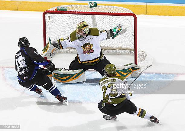Matej Machovsky of the Brampton Battalion slides over to stop Max Domi of the London Knights in an OHL game on February 1 2013 at the Budweiser...