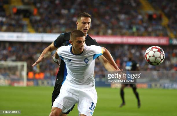 Matej Mitrovic of Club Brugge and Vitaliy Mykolenko of Dynamo fight for the ball during the UEFA Champions League third qualifying round first leg...