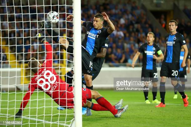 Matej Mitrovic of Club Brugge KV clears the ball off the goal line as Goalkeeper, Simon Mignolet attempts the save during the UEFA Champions League,...