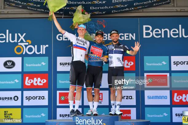 Matej Mohoric of Slovenia and Team Bahrain Victorious, Sonny Colbrelli of Italy and Team Bahrain Victorious blue leader jersey and Victor Campenaerts...