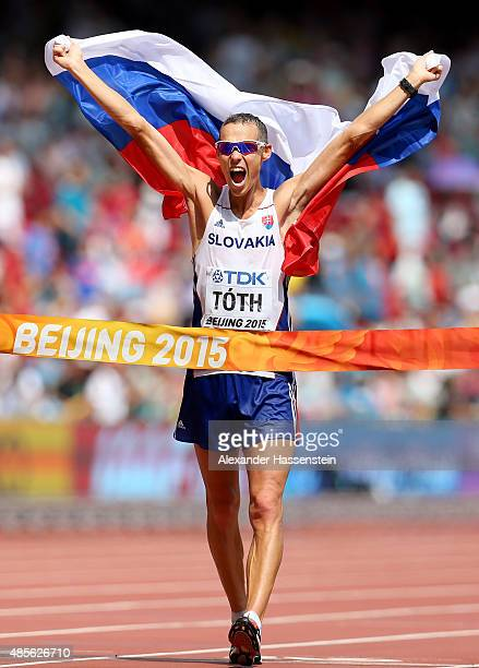 Matej Toth of Slovakia celebrates after crossing the finish line to win gold in the Men's 50km Race Walk during day eight of the 15th IAAF World...