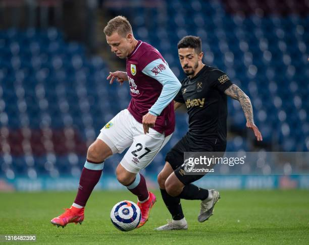 Matej Vydra of Burnley and Manuel Lanzini of West Ham United in action during the Premier League match between Burnley and West Ham United at Turf...