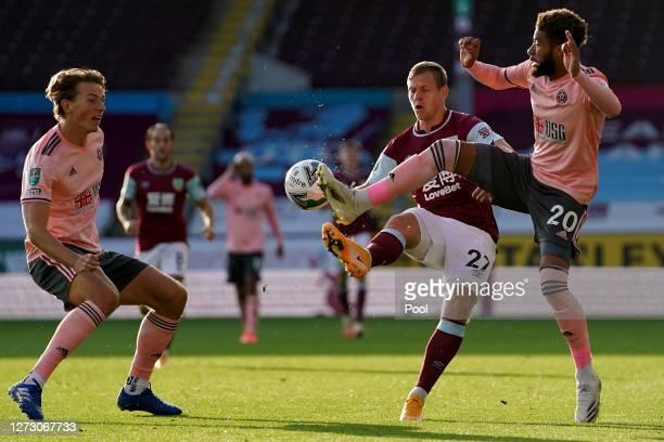 Matej Vydra of Burnley battles for possession with Jayden Bogle of Sheffield United and Sander Berge of Sheffield United during the Carabao Cup...