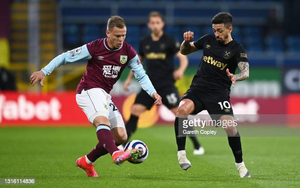 Matej Vydra of Burnley battles for possession with Manuel Lanzini of West Ham United during the Premier League match between Burnley and West Ham...