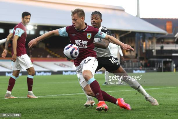 Matej Vydra of Burnley battles for possession with Mario Lemina of Fulham during the Premier League match between Fulham and Burnley at Craven...