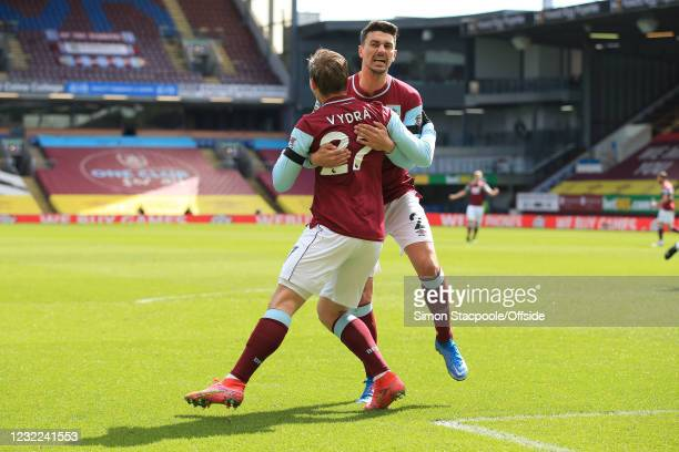 Matej Vydra of Burnley celebrates scoring the opening goal with Matthew Lowton during the Premier League match between Burnley and Newcastle United...