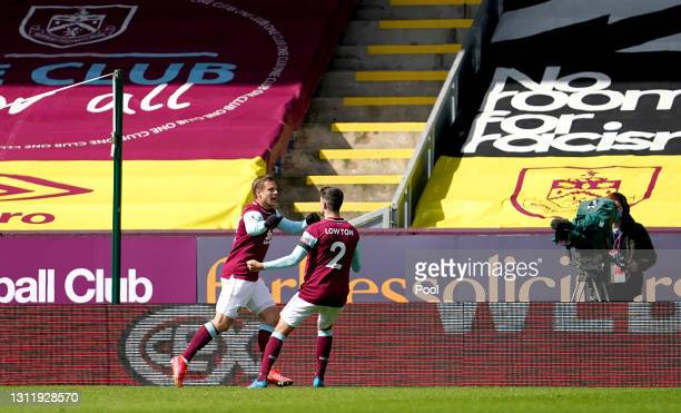Matej Vydra of Burnley celebrates with Matthew Lowton after scoring their team's first goal during the Premier League match between Burnley and...