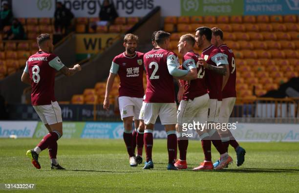 Matej Vydra of Burnley celebrates with team mates after scoring their side's fourth goal which is later ruled out after a VAR review for offside...