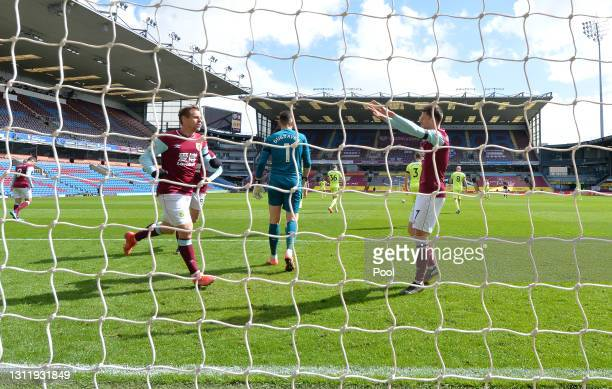Matej Vydra of Burnley celebrates with teammate Johann Gudmundsson after scoring their team's first goal during the Premier League match between...