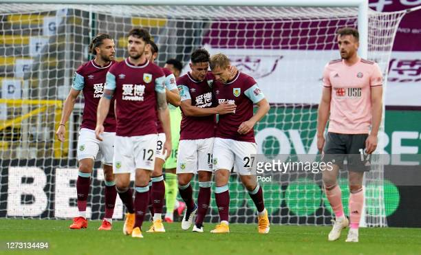 Matej Vydra of Burnley celebrates with teammates after scoring his sides first goal during the Carabao Cup second round match between Burnley and...