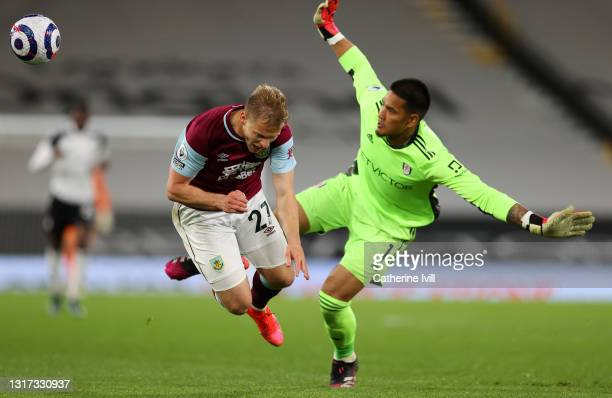 Matej Vydra of Burnley collides with Alphonse Areola of Fulham during the Premier League match between Fulham and Burnley at Craven Cottage on May...