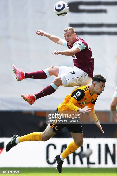 Matej Vydra of Burnley goes over the top of Rayan Ait-Nouri of Wolverhampton Wanderers during the Premier League match between Wolverhampton...