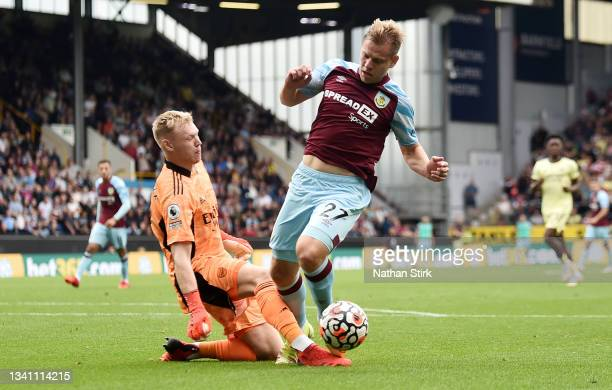 Matej Vydra of Burnley is challenged by Aaron Ramsdale of Arsenal leading to a penalty which is overturned following a VAR review during the Premier...