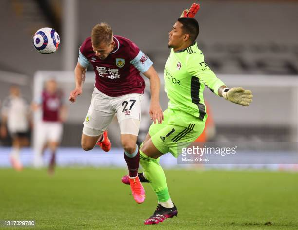 Matej Vydra of Burnley is challenged by Alphonse Areola of Fulham inside the penalty area during the Premier League match between Fulham and Burnley...
