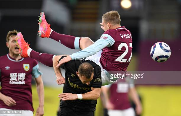 Matej Vydra of Burnley is challenged by Vladimir Coufal of West Ham United during the Premier League match between Burnley and West Ham United at...