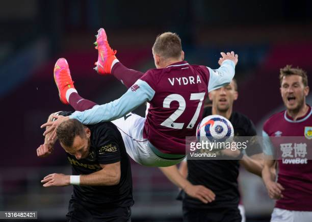 Matej Vydra of Burnley jumps above Vladimir Coufal of West Ham United during the Premier League match between Burnley and West Ham United at Turf...