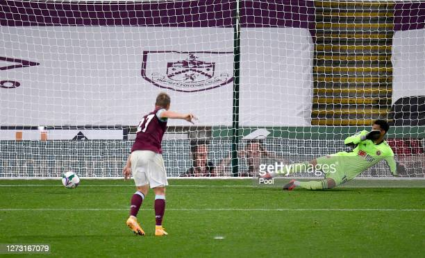 Matej Vydra of Burnley scores during the penalty shootout during the Carabao Cup second round match between Burnley and Sheffield United at Turf Moor...