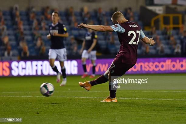 Matej Vydra of Burnley scores his sides second goal during the Carabao Cup third round match between Millwall and Burnley at The Den on September 23,...