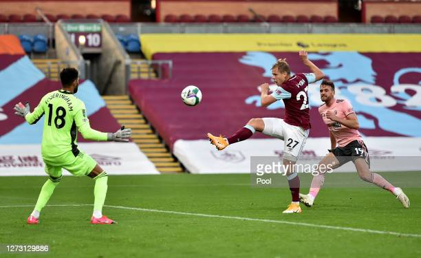 Matej Vydra of Burnley scores his team's first goal during the Carabao Cup second round match between Burnley and Sheffield United at Turf Moor on...