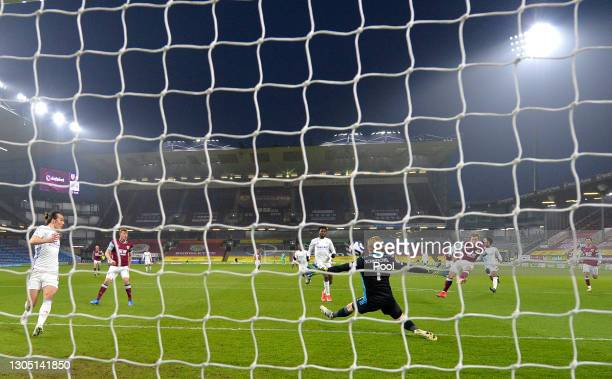 Matej Vydra of Burnley scores their sides first goal past Kasper Schmeichel of Leicester City during the Premier League match between Burnley and...
