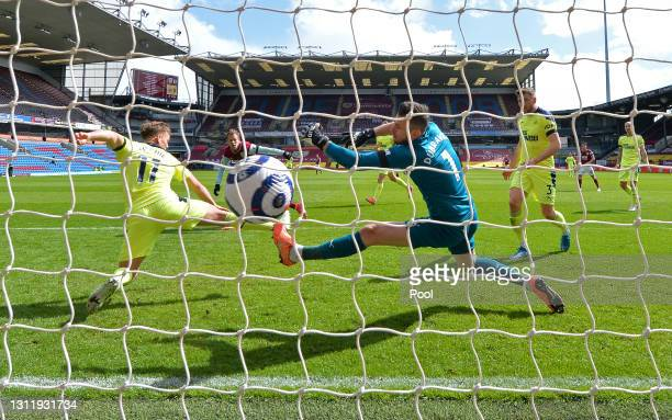 Matej Vydra of Burnley scores their team's first goal past Martin Dubravka and Matt Ritchie of Newcastle United during the Premier League match...