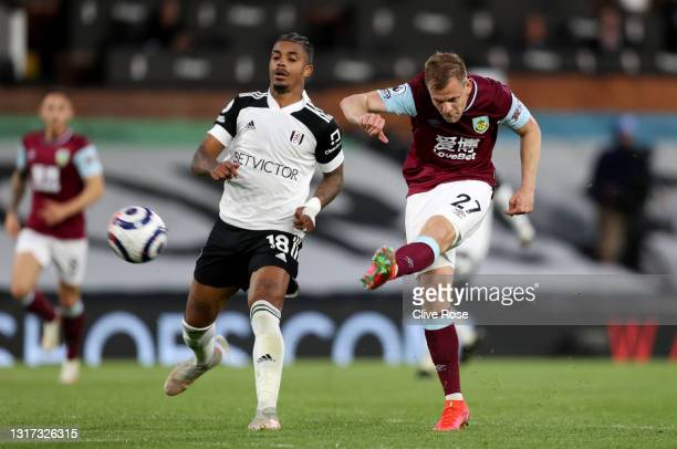 Matej Vydra of Burnley shoots whilst under pressure from Mario Lemina of Fulham during the Premier League match between Fulham and Burnley at Craven...