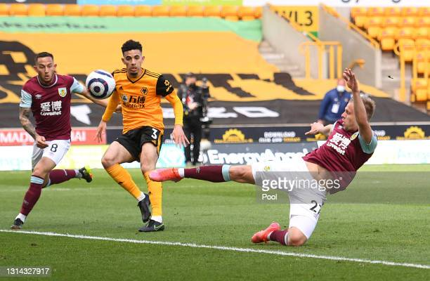 Matej Vydra of Burnley shoots whilst under pressure from Rayan Ait-Nouri of Wolverhampton Wanderers during the Premier League match between...
