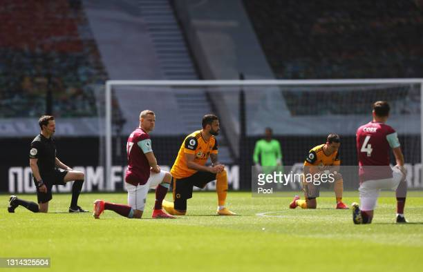 Matej Vydra of Burnley, Willian Jose of Wolverhampton Wanderers and teammates take a knee in support of the Black Lives Matter movement prior to the...