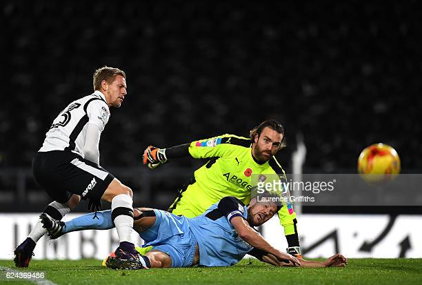 Matej Vydra of Derby County battles with Lee Camp and Richard Wood of Rotherham United during the Sky Bet Championship match between Derby County and...