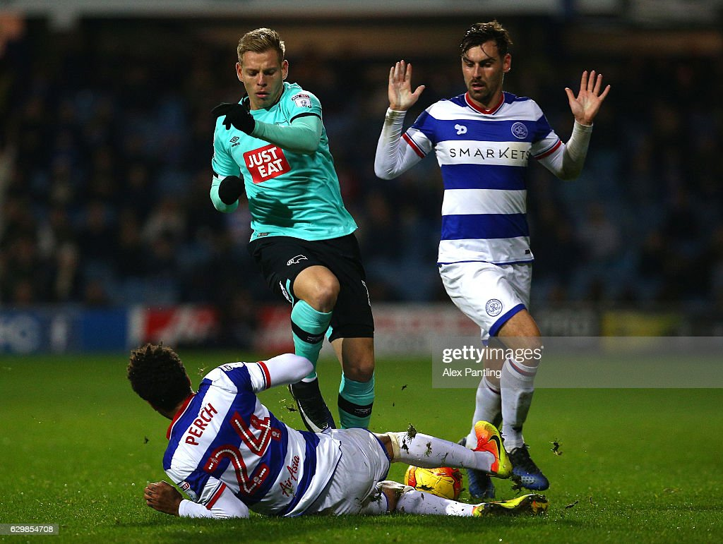 Matej Vydra of Derby County is tackled by James Perch of QPR during the Sky Bet Championship match between Queens Park Rangers and Derby County at Loftus Road on December 14, 2016 in London, England.