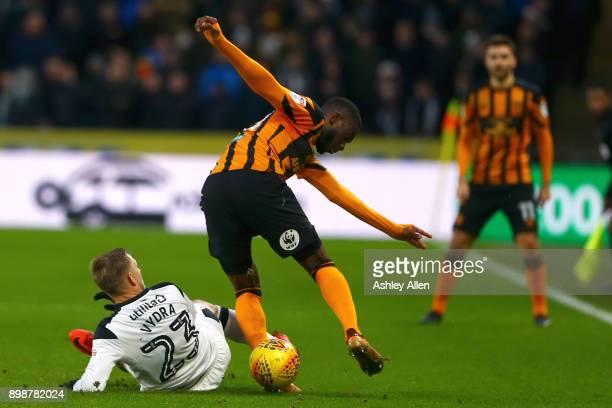 Matej Vydra of Derby County tackles Fikayo Tomori of Hull City during the Sky Bet Championship match between Hull City and Derby County at KCOM...