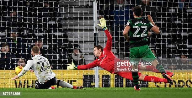 Matej Vydra of Derby scores past QPR goalkeeper Alex Smithies during the Sky Bet Championship match between Derby County and Queens Park Rangers at...