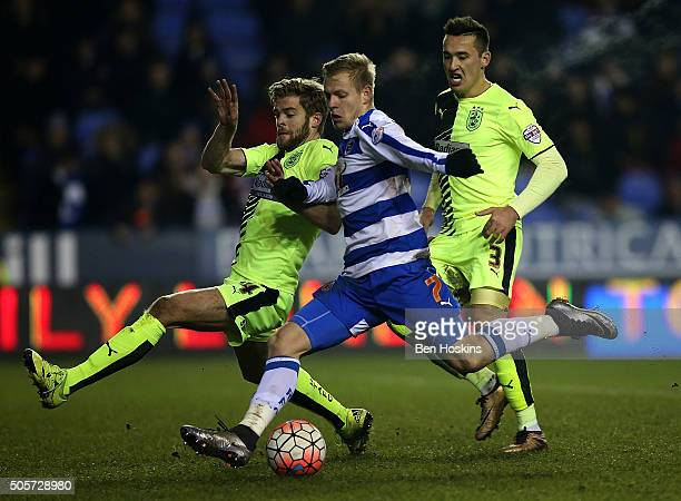 Matej Vydra of Reading beats Martin Cranie of Huddersfield to score his third and his team's fourth goal during The Emirates FA Cup Second Round...