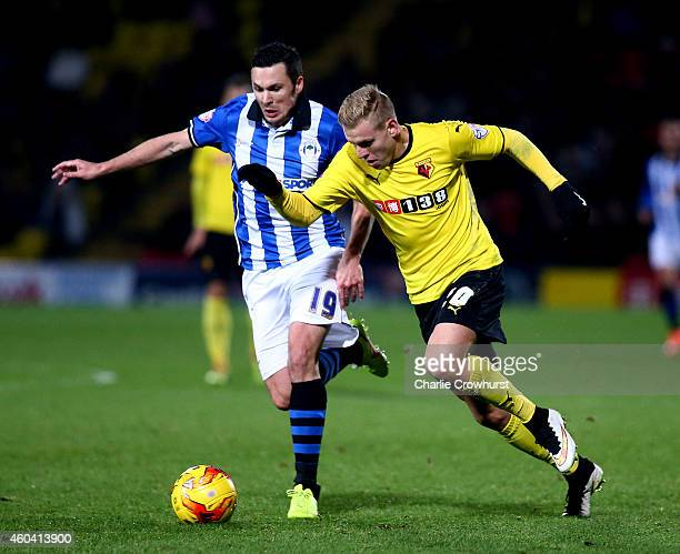 Matej Vydra of Watford attacks past Wigan's Don Cowie during the Sky Bet Championship match between Watford and Wigan Athletic at Vicarage Road on...